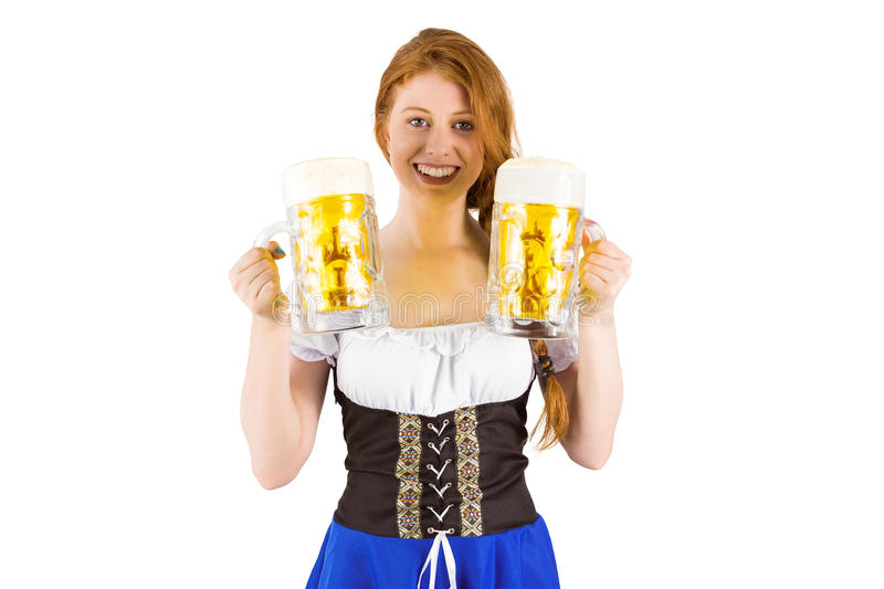 Girl holding jugs of beer. On white background royalty free stock images