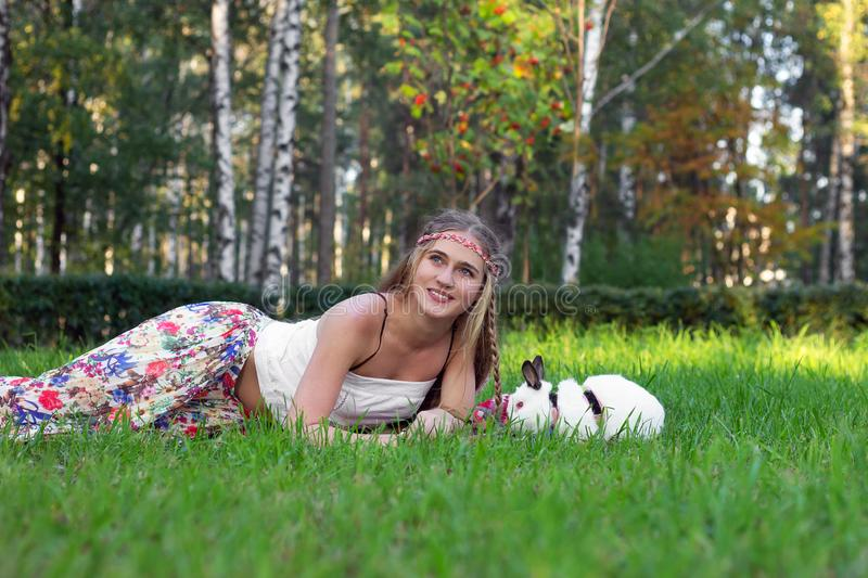 Girl holding kisses a rabbit  pet happiness royalty free stock photography