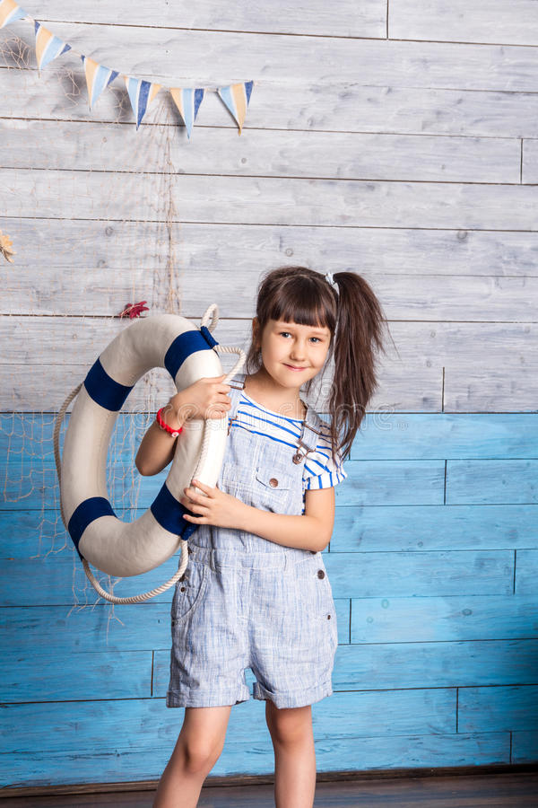 Girl holding a life preserver royalty free stock photos