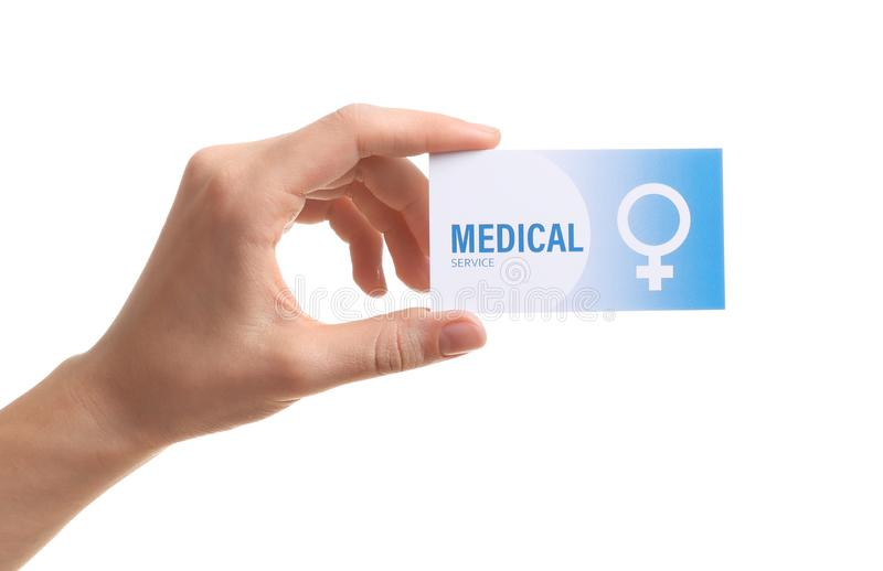 Girl holding medical business card on white, closeup. Women`s health service. Girl holding medical business card isolated on white, closeup. Women`s health stock photo