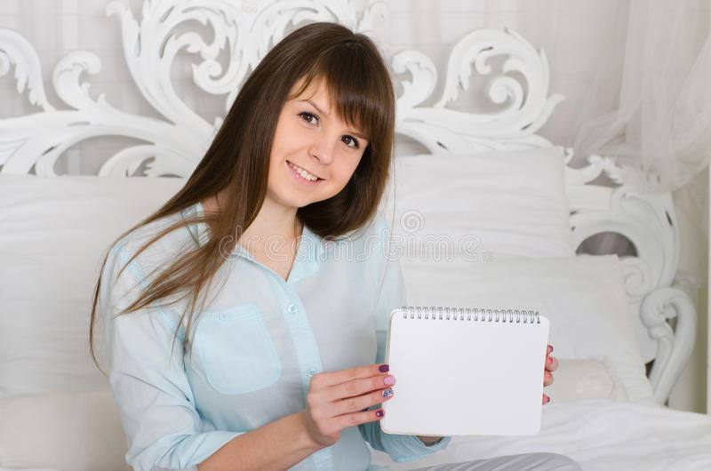 Girl holding a notebook royalty free stock images