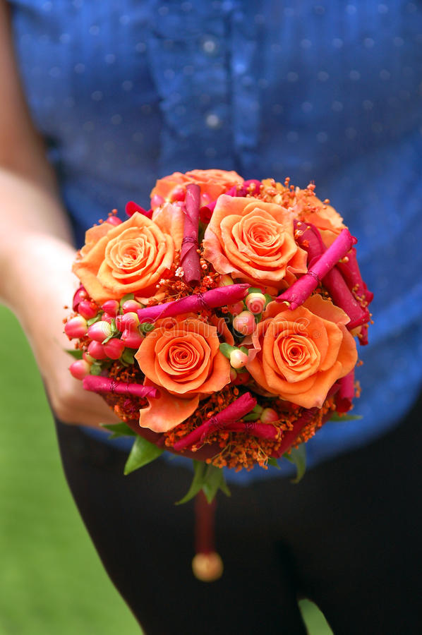 Download Girl Holding An Orange Bouquet Stock Image - Image: 14169783