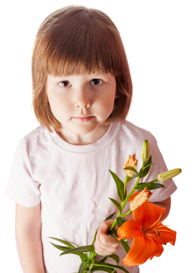 Girl holding orange flower royalty free stock images