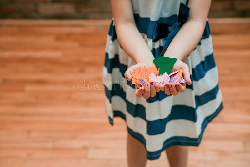 Girl Holding Orange and Green Cut Papers royalty free stock image