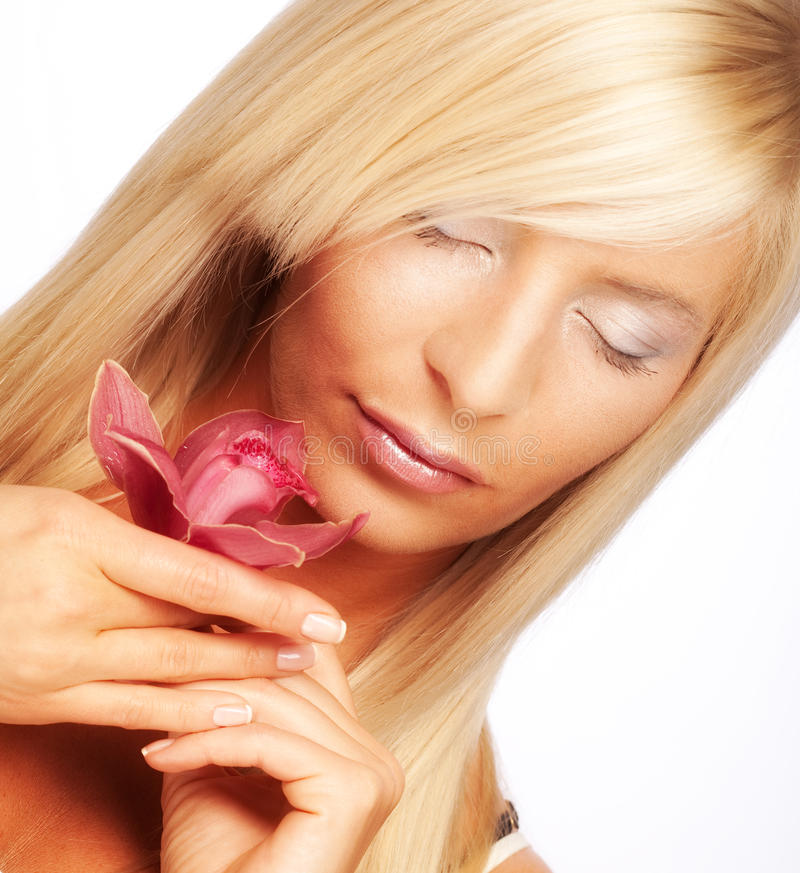 Girl holding orchid flower stock photography