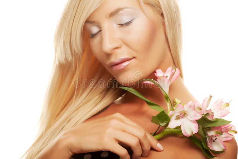 Girl holding orchid flower stock photos