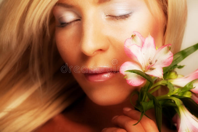 Girl holding orchid flower royalty free stock photography