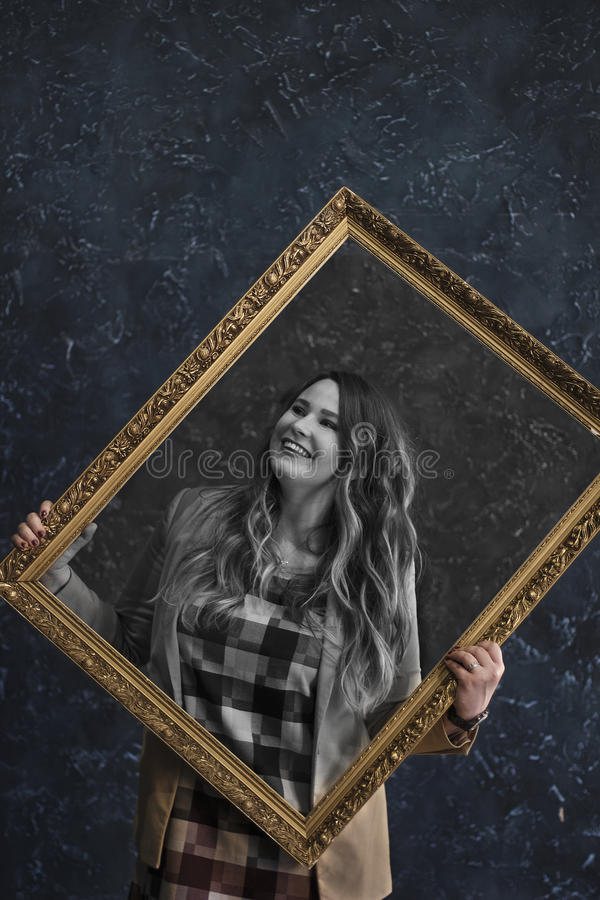 Girl holding a picture. royalty free stock image