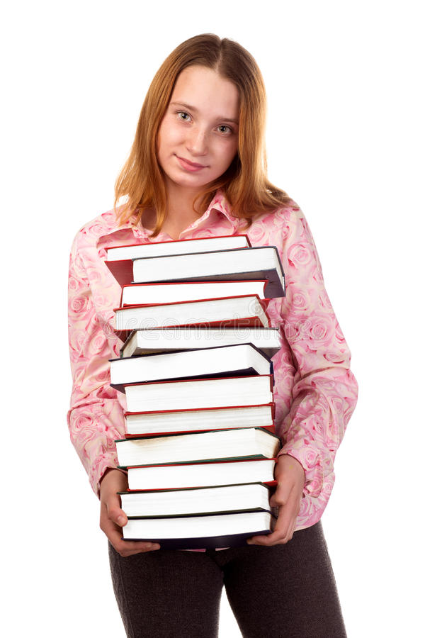 Girl holding a pile of color books. stock images