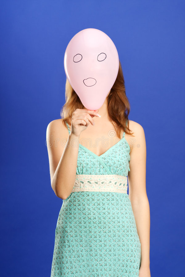 Girl holding pink surprised balloon royalty free stock image