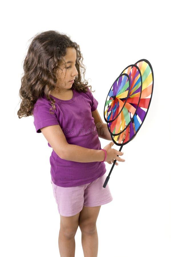 Girl holding a pinwheel royalty free stock photography