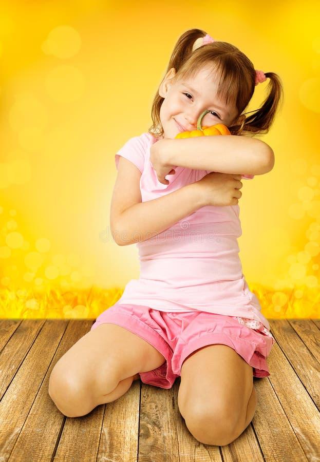 Girl holding pumpkin royalty free stock photo