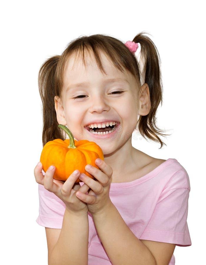 Girl holding pumpkin stock photos