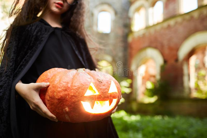Girl Holding Pumpkin Lantern on Halloween royalty free stock photography