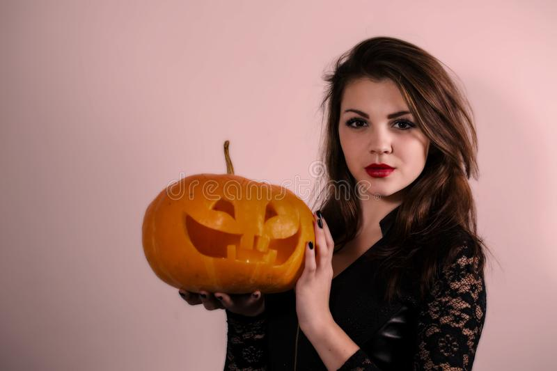 Girl holding a pumpkin lantern stock photo