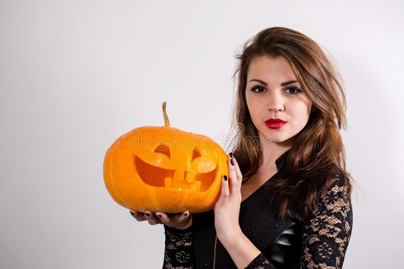Girl holding a pumpkin royalty free stock photo