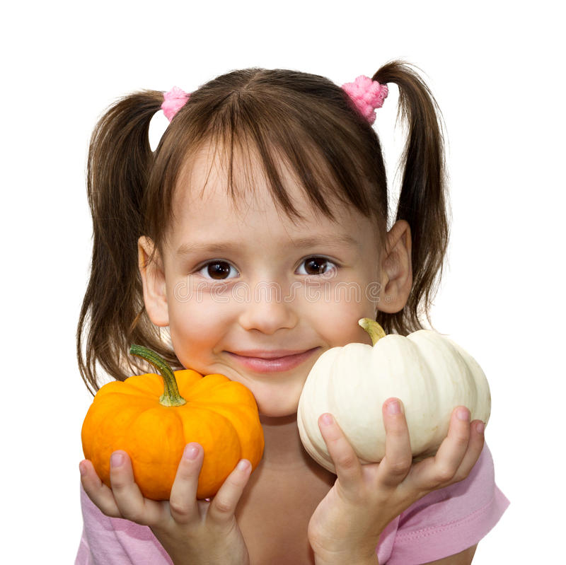 Girl holding pumpkins royalty free stock images