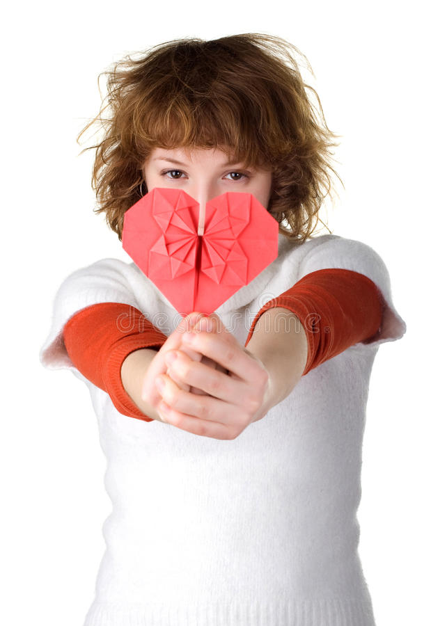 Girl holding red origami heart royalty free stock photo