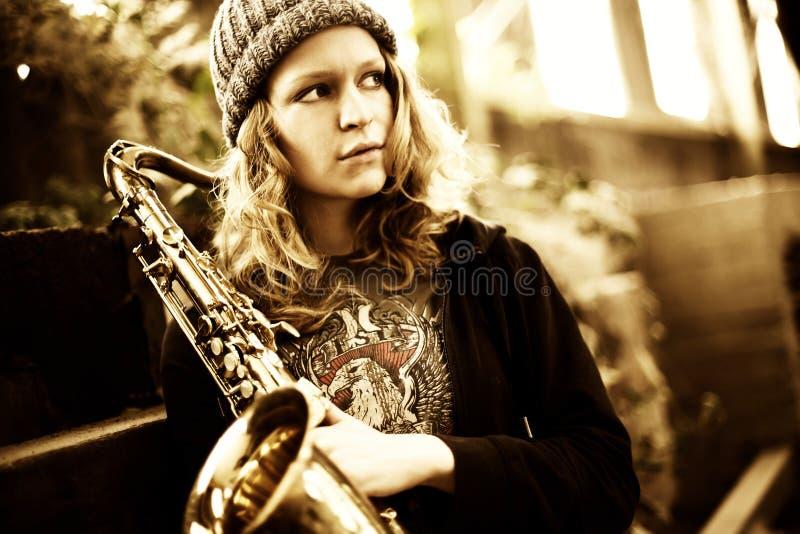 Download Girl Holding Saxophone, Looking Far Away Stock Image - Image: 15057613