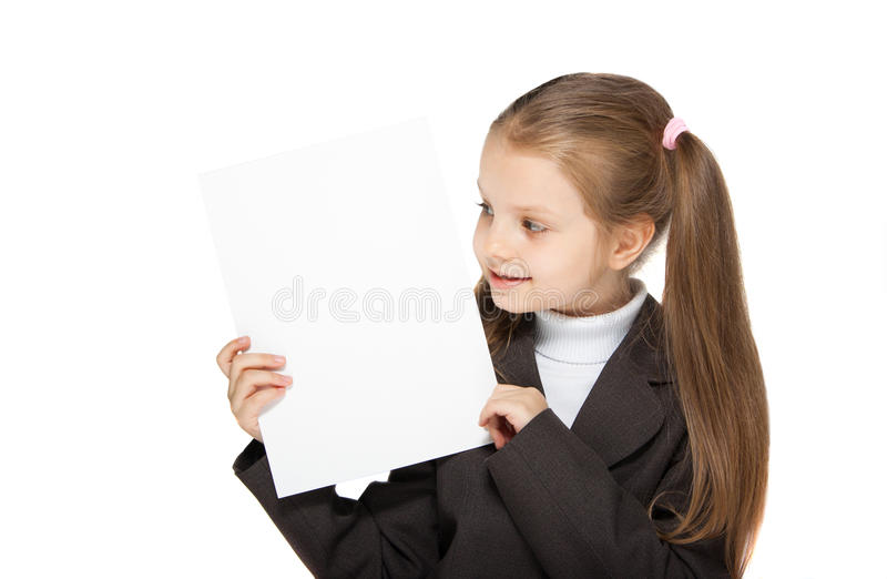 Girl holding a sheet of paper. This image has attached release royalty free stock image