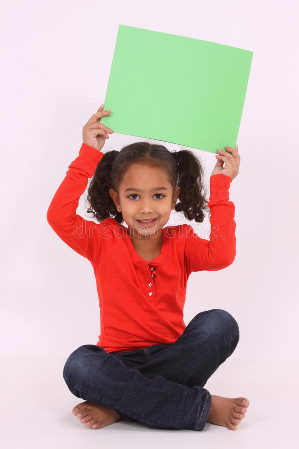 Girl holding a sign stock images