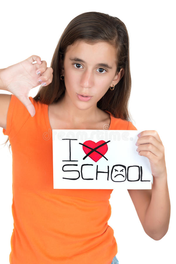 Girl holding a sign with the words I hate school. Teenage girl holding a sign with the words I hate school isolated on white stock photos