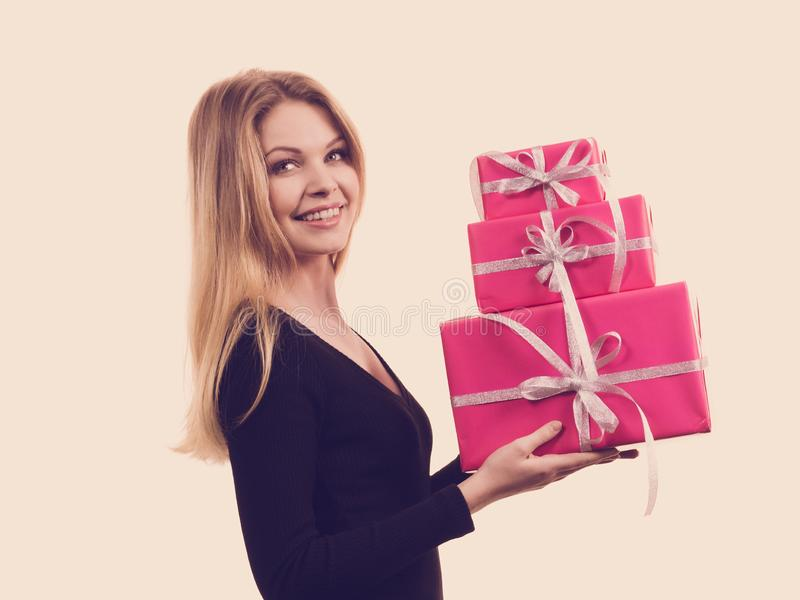 Girl holding stack of pink gift boxes royalty free stock images