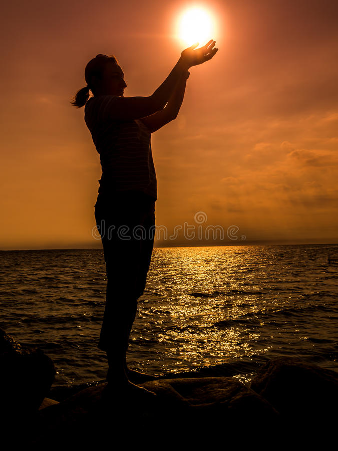 Girl holding the Sun stock photography