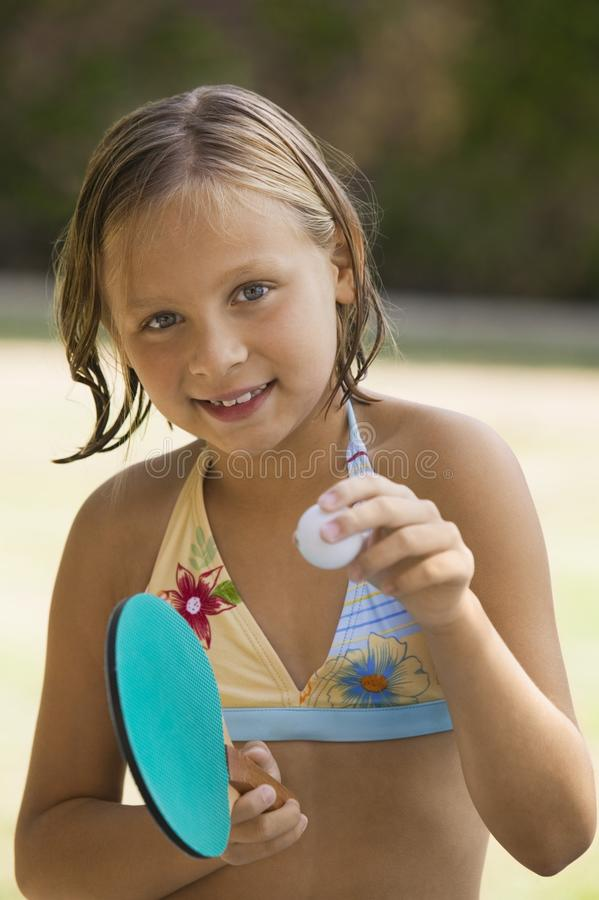 Girl holding table tennis paddle stock photos