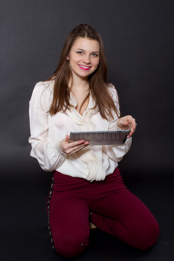 Download Girl Holding A Tablet Computer Stock Photos - Image: 28845073