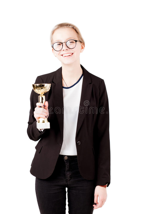 Girl holding trophy in hand isolated royalty free stock photos