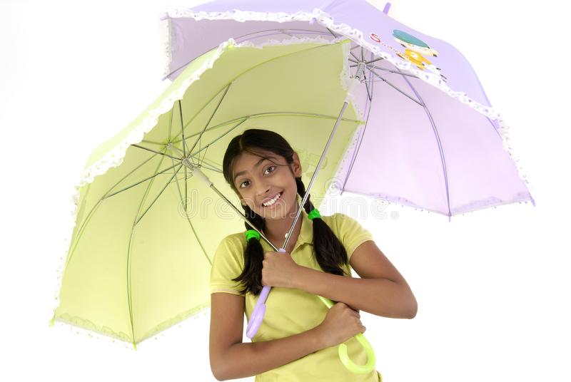 Girl holding two umbrella