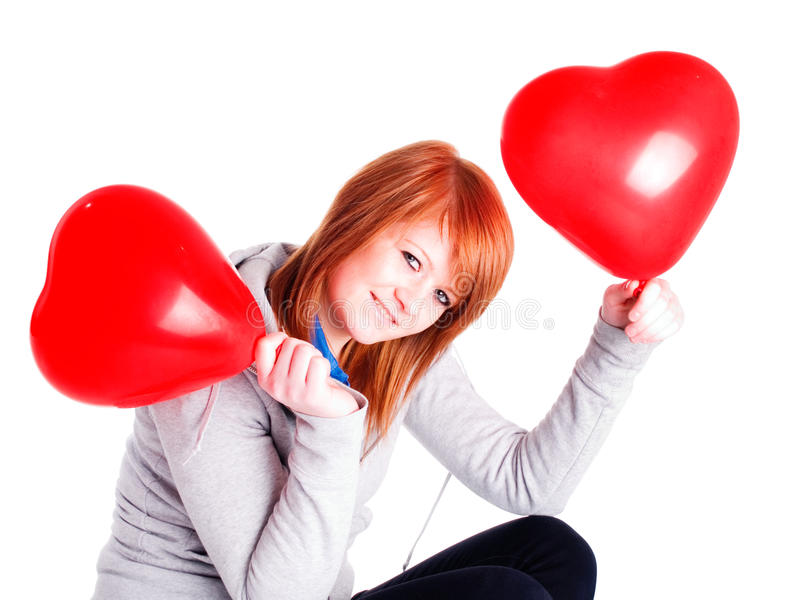Girl Holding Two Valetine Balloon Hearts Stock Image
