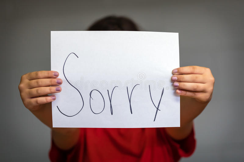 Girl Holding Up Sorry stock photos