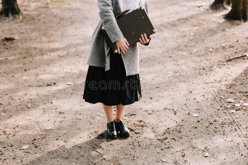 Girl with a vintage suitcase. Traveler with retro luggage. Travel concept. Girl holding a vintage suitcase. Traveler with retro luggage. Travel concept stock image