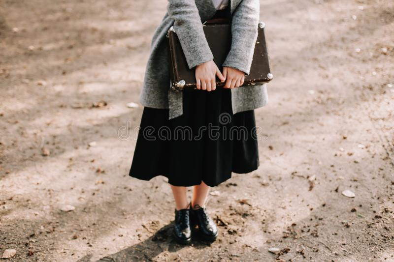 Girl with a vintage suitcase. Traveler with retro luggage. Travel concept. Girl holding a vintage suitcase. Traveler with retro luggage. Travel concept royalty free stock photography