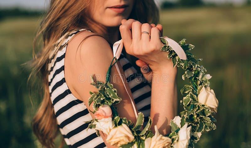 Girl holding a wedding wreath stock photo