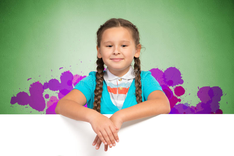 Girl holding a white banner royalty free stock photography