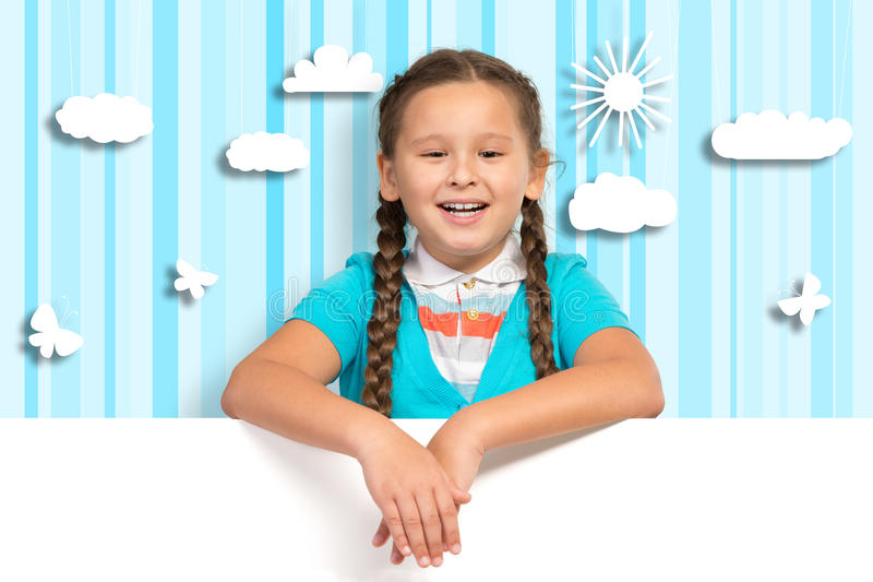 Girl holding a white banner royalty free stock image