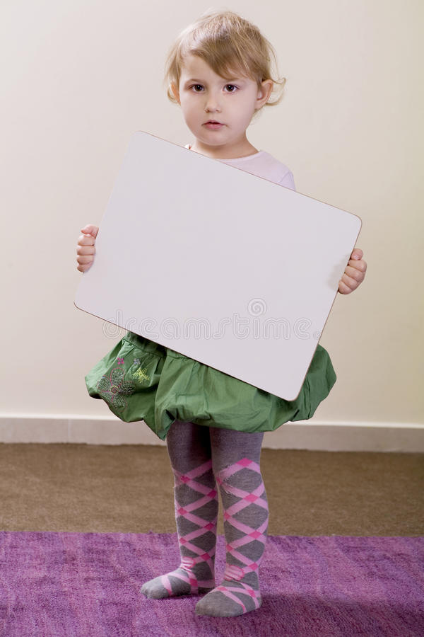 Girl holding a white board