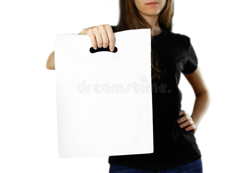 Girl holding a white plastic bag. Close up. Isolated background royalty free stock photo