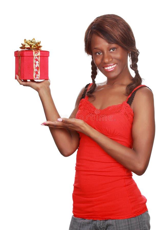 Girl holding xmas gift royalty free stock photography