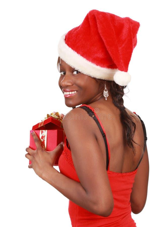 Girl holding xmas gift stock photography