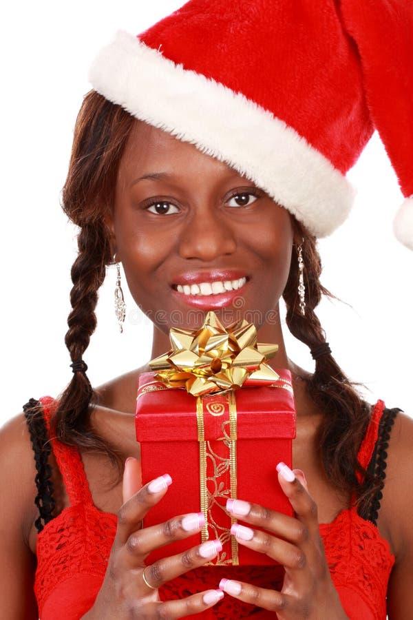 Girl holding xmas gift stock images