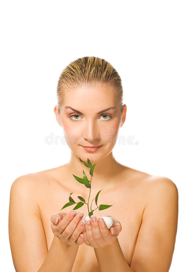 Girl holding young plant royalty free stock image