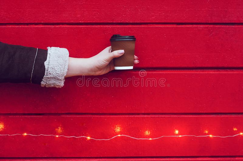 A girl holds a cup of coffee or tea stock photos