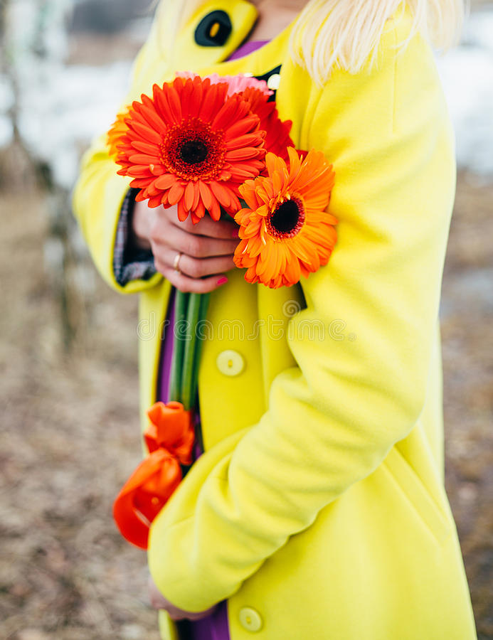 Girl holds flowers, bright colors background stock photos