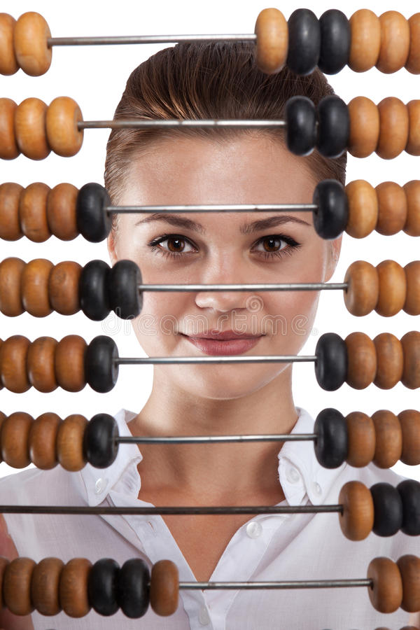 Girl holds in front of abacus royalty free stock images