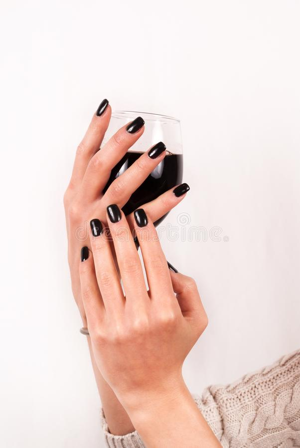 Girl Holds Glass Of Red Wine With Hands With Black Nails On White ...