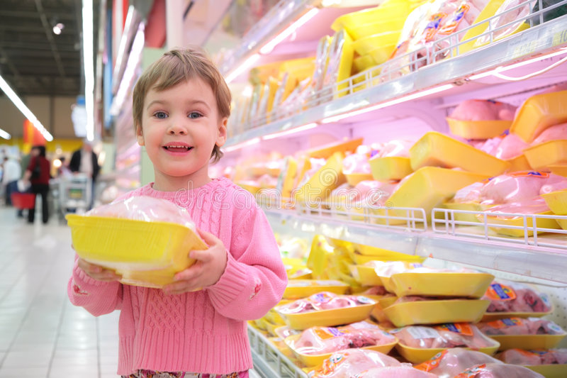 Girl holds in hands packing with hen in shop royalty free stock image